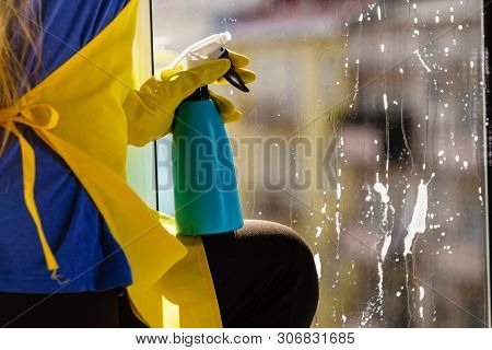 Person Spraying Window Cleaning Detergent In Spray Bottle. House Clean Products, Household Care Equi