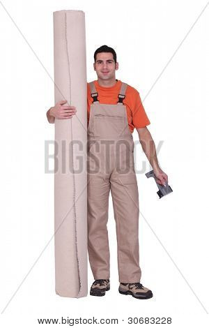 Man stood with carpet roll