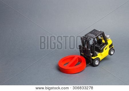 A Yellow Forklift Truck Cannot Lift A Red No Symbol. The Concept Of Prohibition, Sanctions And Restr
