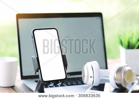 Close Up Phone On Holder Showing Blank Screen