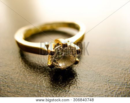 Gold Ring  Diamond Gem Closeup. Gold Wedding Or Engagement  Ring Decorated With Diamond
