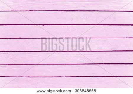 A Wall Of Pink Boards, The Construction Of Wooden Houses, Natural Materials. Wood Texture Background