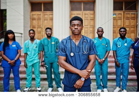 Group Of African Medical Students Posed Outdoor Against University Door.