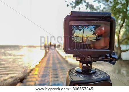 Action Camera Mounted On A Tripod And Make A Time Lapse Of The Pier And Sunrise