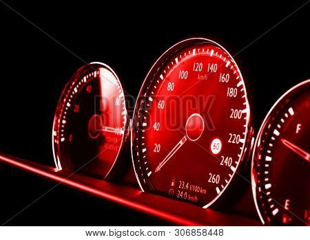 Close Up Shot Of A Red Speedometer In A Car. Car Dashboard. Dashboard Details With Indication Lamps.
