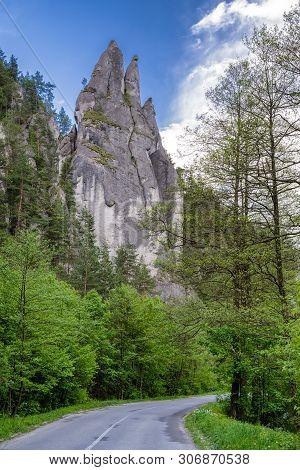 Empty Road Under Rock Formation In Sulov Rocks At Slovakia