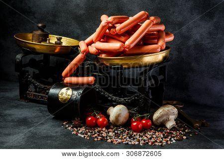 Big Heap Of Raw Long Thin Wieners On Antiquarian Scales