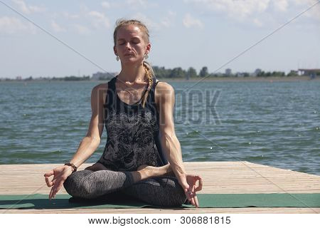 Meditation. Young Woman Sitting In The Lotus Position