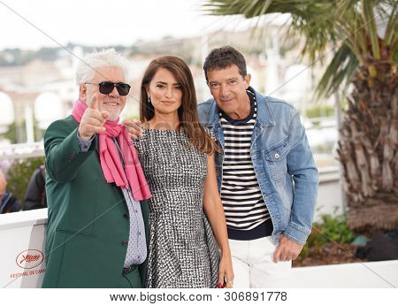 CANNES, FRANCE - MAY 18, 2019: Pedro Almodovar, Penelope Cruz and Antonio Banderas attend the photocall for