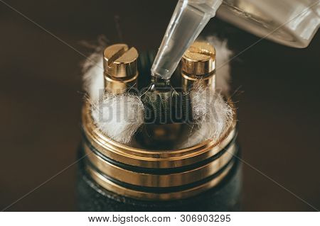 Vape Atomizer Or Rda For Vaping Or E-cigarette With Coil And Cotton Stripes Wetted With E-liquid, Cl