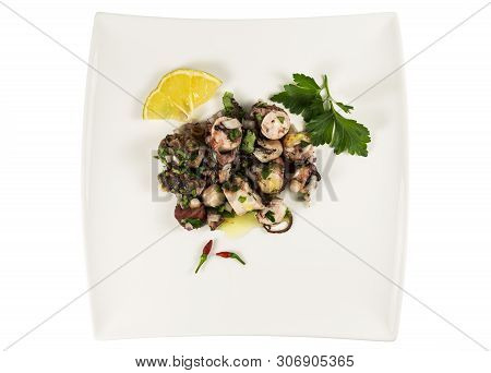 Beautiful Octopus Salad Presented On A Traditional Portuguese Style With Finely Diced Red Onion, Par