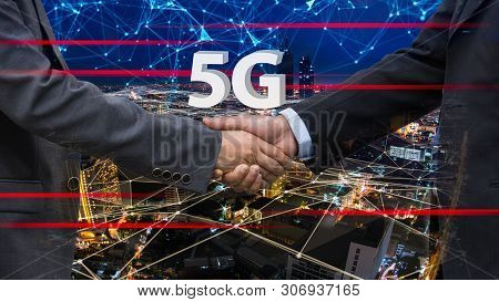 Close Up Of Handshake On Abstract City And 5g Background.teamwork Concept. Double Exposure. Filtered