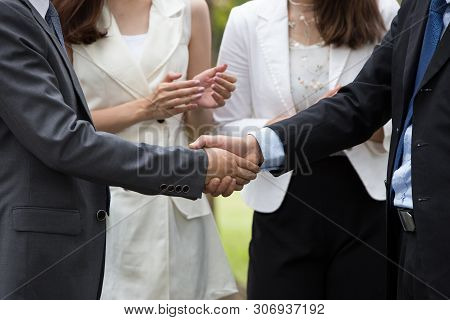 Business People Handshake Success Business.businessman And Business Women Clap Their Hands To Congra