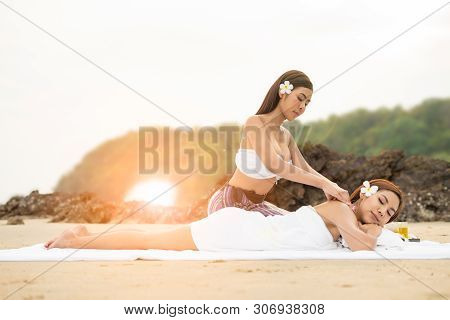 Young Asian Woman In Beach Spa.picture Of Beautiful Woman In Spa Salon Getting Massage On The Beach