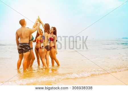 Group Of People Party On The Beach.group Of Happy Young People Drinking And Dancing At The Beach On