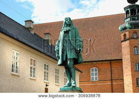 Copenhagen, Denmark: May 1, 2019 - The Statue Of Chancellor Peder Griffenfeld And A Tower In Copenha