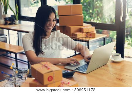 Seller Prepare To Send Goods To Customer After Checking Order.