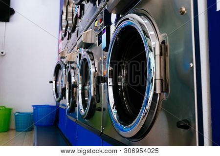 Bunch Of Professional Industrial Washing And Drying Machines In Laundry Service Store - Clothing Cle