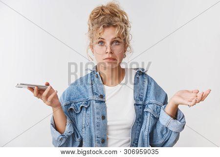 Awkward Unsure Clueless Cute Clumsy European Blond Female Assistant Wear Glasses Messy Bun Smirking