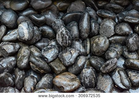 Stock Photo Wet Black Shiny Stones With Water Drops