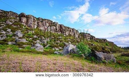 Boulders Below Great Wanney Crag, On The Edge Of Northumberland National Park, Is A Remote Escarpmen