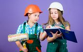 Home improvement activities. Kids choosing paint colour for their new room. Kids girls planning renovation. Children sisters run renovation their room. Amateur renovation. Sisters renovating home poster
