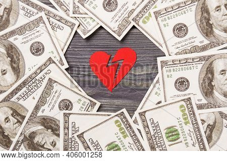 Broken Heart And Pile Of Dollars. Divorce Or Mock Marriage Concept.