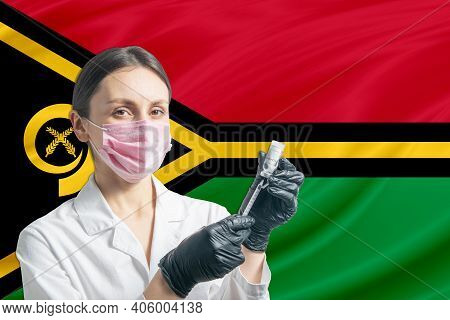 Girl Doctor Prepares Vaccination Against The Background Of The Vanuatu Flag. Vaccination Concept Van