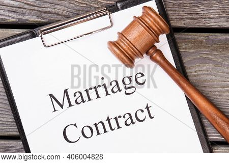 Marriage Contract And Legal Gavel. Brown Wooden Hammer And Clipboard With Marriage Contract.