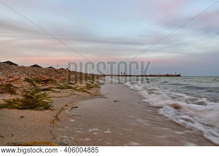 Beautiful Evening Sunset On The Beach Of The Sea Of Azov. Colorful Colors Of Sky And Sea.