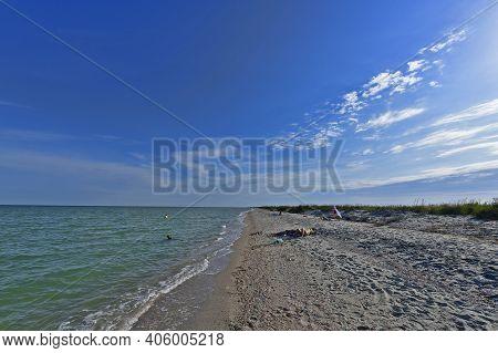 Ukraine, Primorsk 06/20/2020. Azov Sea Beach In Dorozhnik Resort. Bungalows, Sun Loungers, Vacatione
