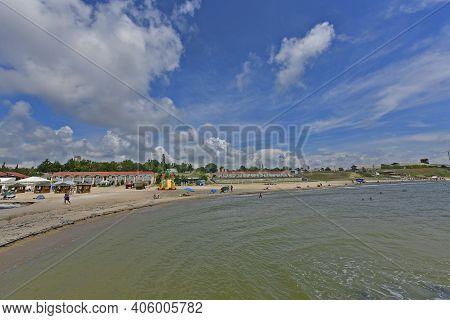 Ukraine, Primorsk 06/22/2020. Azov Sea Beach In Dorozhnik Resort. Bungalows, Sun Loungers, Vacatione