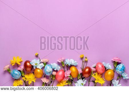 Easter Background With Easter Eggs And Spring Flowers.