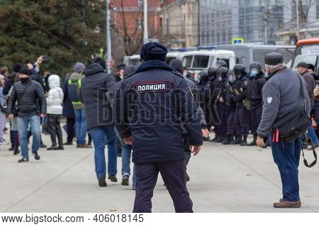 Krasnodar, Russia - January 31, 2021. Police Officer Watching Mans Arrest. Opposition Activists Prot