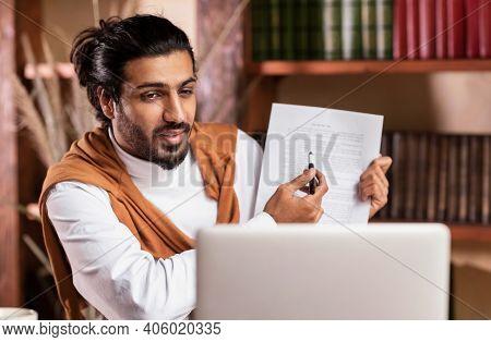 Distant Teaching. Indian Teacher Guy Having Class Via Video Call E-teaching Remotely Showing Noteboo