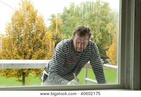 Painter On A Scaffold