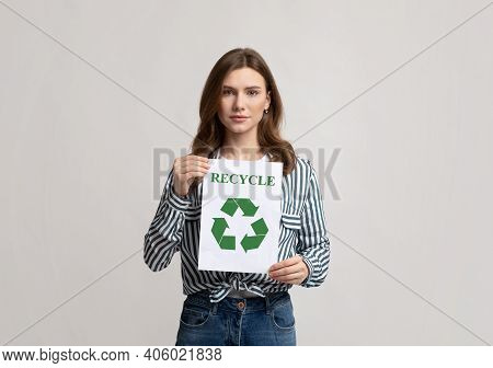 Recycling Concept. Young Beautiful Lady Demonstrating Placard With Green Recycle Sign, Millennial Ec