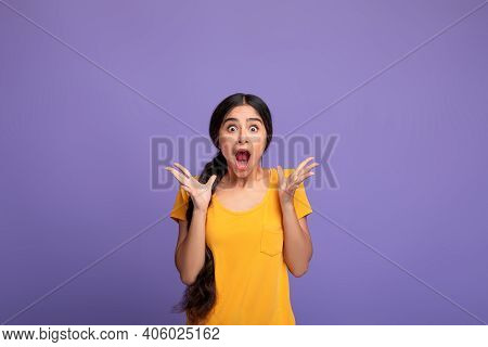 Unbelievable. Portrait Of Excited Overjoyed And Shocked Young Indian Woman Looking At Camera And Spr