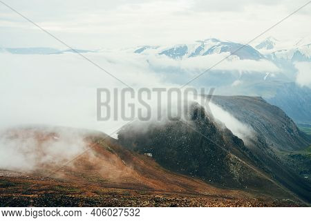 Atmospheric Alpine Landscape To Giant Low Cloud Above Rocky Mountains. Big Thick Clouds Above Highla