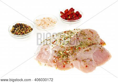 Raw Turkey Breast With Grilling On White Plate. Studio Photo