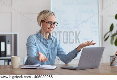 Experienced English Teacher Giving Online Lesson On Laptop, Chatting With Students, Participating In
