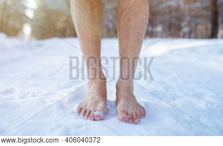 Cold Training And Acclimation Concept. Senior Guy Standing Barefoot On Snow At Winter Forest, Croppe