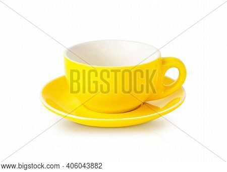 Empty Yellow Teacup With Saucer Isolated On White