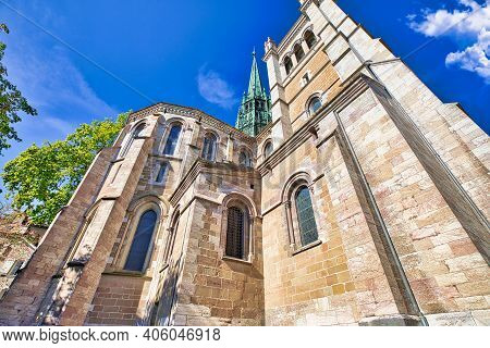 Bottom View Of Romanesque Lateral Facade, Bell Tower And Gothic Spire Of Saint-pierre Cathedral In A