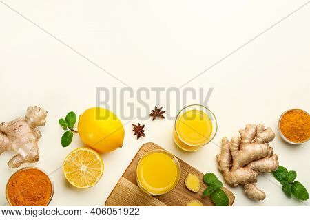 Immunity Boosting Drink And Ingredients On White Background, Flat Lay. Space For Text