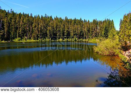 Summer Reflections - A View Across Tule Lake In July - Cascade Range - Near Marion Forks, Or