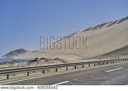 Ruta 5, Panamericana, Is Leading Along The Pacific Coast Of Chile Through The Atacama Desert With Hi