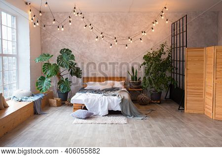Cozy Bedroom Area At Luxury Studio Apartment With A Free Layout In A Loft Style With Big Panoramic W