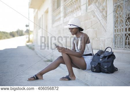 young woman uses a smartphone