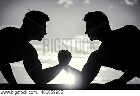 Rivalry, Vs, Challenge, Hand Wrestling. Sunset, Sunrise. Silhouette Of Hands That Compete In Strengt